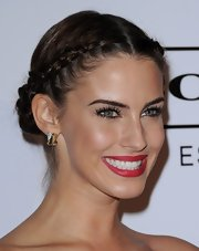 Jessica Lowdnes adorable, braided 'do may look complicated, but if you're familiar with French braiding, it's definitely a do-it-yourself look. Begin by making a center part and creating three-inch diagonal sections along the hairline. Start near the part and being the French braid along the hairline. Once the braid reaches behind the ear, continue a regular braid on each side,  incorporating all of the loose strands.  For the final step, wrap braids around each other and secure with bobby pins.