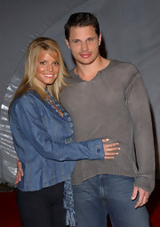 Jessica Simpson showed her layers off with a slight curl out while at a fashion show party with Nick Lachey.