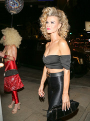 Joanna Krupa paired a studded clutch with her Olivia Newton-John costume for the Casamigos Halloween party.