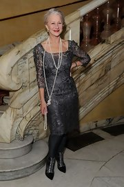 Helen Mirren looked elegant and sophisticated in a gray lace cocktail dress and pearls at 'The Audience' curtain call.