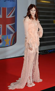 Florence topped off her intricate frock with metallic-detailed wedges.