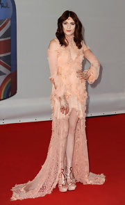 Florence Welch wore this ethereal peach chiffon gown to the Brit Awards.