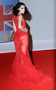 Jessie J made a statement in this sheer red gown with tonal embroidery for the Brit Awards.