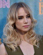 Suki Waterhouse looked darling with her shoulder-length waves and parted bangs at the premiere of 'The Bad Batch.'