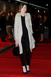 Laura Carmichael carried a black patent leather purse at the 'Book of Mormon' press night.
