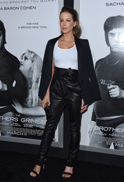 Kate Beckinsale polished off her monochrome look with strappy black mules by Stuart Weitzman.