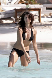 Penelope Cruz wears a black halter-top bikini.
