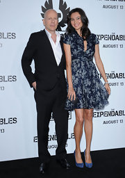 Posing beside husband Bruce Willis at 'The Expendables' premiere in Hollywood, Emma Heming was a vision of loveliness in her gorgeous floral print dress.