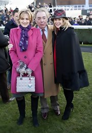 Amanda Holden stayed warm at the Hennessy Gold Cup in a fur-trimmed black coat.