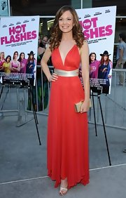 Rachel Boston wore this elegant red gown with gold straps and a gold waist to the premiere of 'The Hot Flashes.'