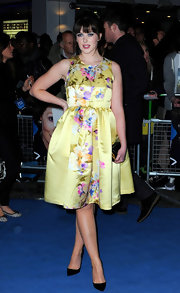 Alexandra Roach was vibrant in a yellow floral print dress for the 'Iron Lady' UK premiere.