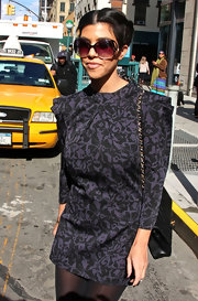Kourtney showed off a more demur side to her style while hitting the streets of NY in butterfly shades.