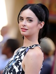 Krysten Ritter pulled her hair up in a high ponytail with center-parted bangs for the 'Lone Ranger' premiere.