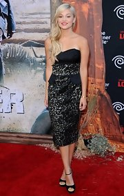 Olivia Holt looked mature and chic in a strapless print dress at the premiere of 'The Lone Ranger.'