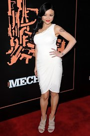 "Tila stepped out at the premiere of ""The Mechanic"" in strappy nude sandals."