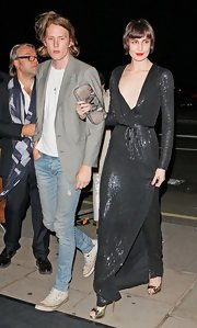 At the Moet & Chandon Etoile Awards, Erin O'Connor accessorized her black sequined wrap dress with a gray leather clutch.