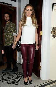 Lauren Pope chose a sleeveless turtleneck for her evening look at 'The Only Way is Essex' wrap party.