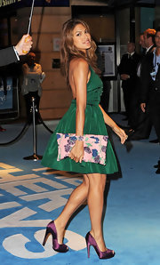 Eva perfectly paired her silk printed clutch with deep purple peep toe pumps.