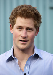 Prince Harry wore his red hair in a casual scruffy 'do for his visit to the Black Mountains.