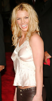 The blonde pop tart sported a tousled wavy hairstyle on the red carpet. This effortless look is young, fresh and perfect for Britney's look.