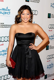 Jenna Ushkowitz added a splash of color to her sweet dotted frock with a glittery red clutch.