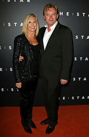 Olivia Newton-John paired her jacket with silk pants  at the Sydney opening of 'The Star.'