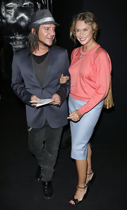John Galliano paired his blazer with a grey fedora hat.