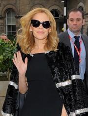 Kylie Minogue amped up the retro-glam feel with a pair of cateye sunnies as she arrived at the BBC Studios.