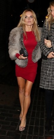 Geri Halliwell layered a luxe fur chubby over her red long-sleeved sheath at the Box Nightclub.
