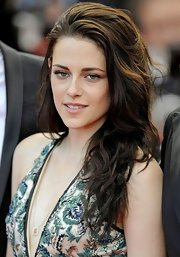 Kristen Stewart arrived for the 'On the Road' premiere in Cannes wearing her dark locks in a mass of messy waves.