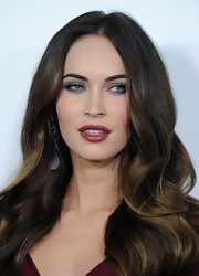 Megan's rich wine-colored pout brought vixen-like edge to her genteel hairstyle.