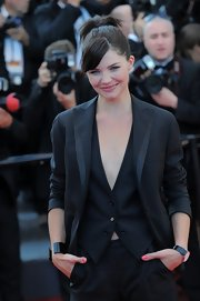 Delphine Chaneac attended the premiere of 'This Must Be The Place' wearing a black boyfriend blazer on top of a vest and slacks.