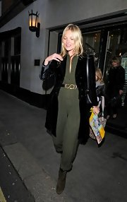 Kate Moss dressed up her green jumpsuit with a fitted velvet evening coat.