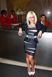 Tila completed her sexy secretary ensemble with a pair of peep-toed white slingback pumps.