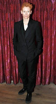 Tilda Swinton wears a masculine black tailored suit to a press junket for her movie 'I am Love'.
