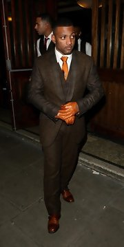 Jonathan Gill added a pop of color to his evening look with orange leather gloves and a matching tie.