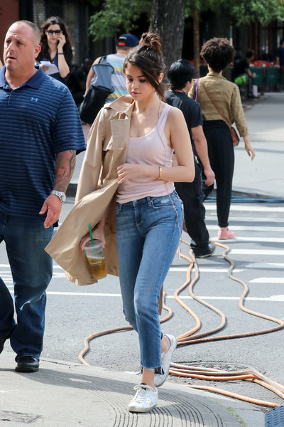 Selena Gomez looked relaxed in a pink tank top and a pair of jeans on the set of her new movie.