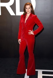 Amy Adams worked a '70s vibe in a red Tom Ford bell-bottom pantsuit during the label's womenswear presentation.