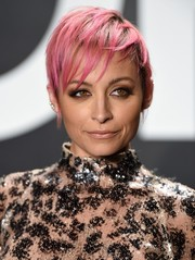 Nicole Richie looked uber cool with her pink pixie at the Tom Ford womenswear presentation.