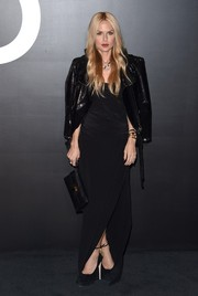 Rachel Zoe toughened up her gown with a shiny black moto jacket.