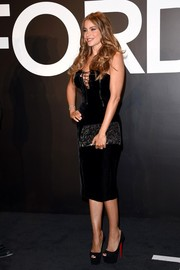 Sofia Vergara was sexy-goth at the Tom Ford presentation in a black velvet strapless dress with a lace-up neckline that revealed her most famous assets.