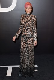 Nicole Richie sizzled in an ogle-worthy, see-through Tom Ford gown, rendered entirely in leopard-patterned sequins, during the brand's womenswear presentation.