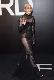 Not surprisingly, Miley Cyrus was all about skin flashing in a sheer black Tom Ford gown during the brand's womenswear presentation.
