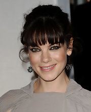 Michelle Monaghan pulled her brunette tresses back in a tousled bun, which showed off her decorative dangle earrings.