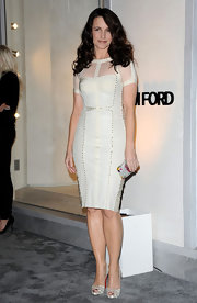 Kristin Davis looked simply stunning in ivory snakeskin peep toe platforms.
