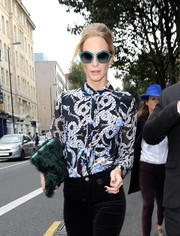 Poppy Delevingne rocked blue oversized shades for the Topshop Unique Spring/Summer 2015 show.