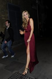 Abbey Clancy's wine-colored evening dress and black strappy sandals were a totally sexy pairing.