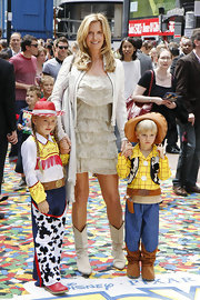 Penny Lancaster matched her outfit with a pair of white boots at the 'Toy Story 3' premiere.