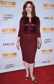 Christina Hendricks topped off her festive look with embellished sandals.
