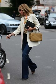 Trinny Woodall accessorized with a stylish tan suede tote while running errands in Notting Hill.